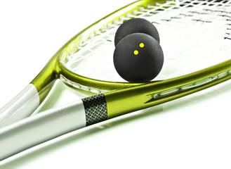 Green and silver squash racket and balls