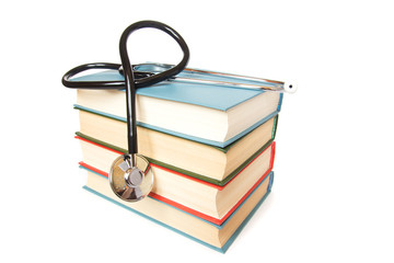 stethoscope and  stack of books