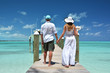 Couple on a wooden jetty. Exuma, Bahamas