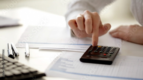 female accountant making fast calculations