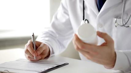 male doctor making a prescription