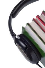 Headphones on books isolated.