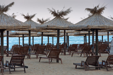 Lounge chairs with a sun canopy on the beach.