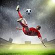 football player striking the ball