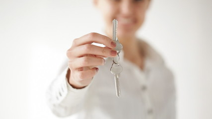 happy woman showing the house keys