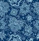 Ornamental indian pattern  with flowers on blue background.