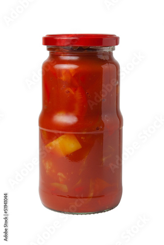 Closed transparent glass jar with canned Lecho (Bulgarian pepper