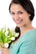Cheerful young woman with bouquet of tulips