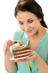 Tempting sweet cake and young hungry woman