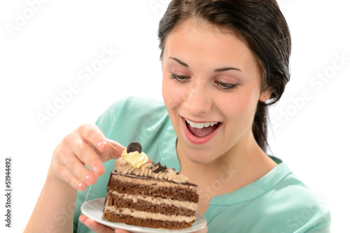Joyful girl eating tasty piece of cake