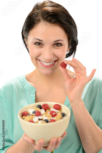 Friendly girl posing with cereal bowl