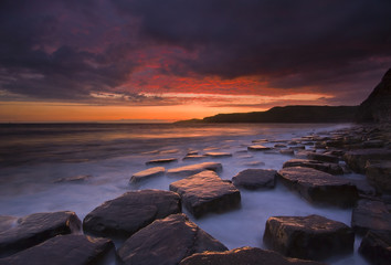 Kimmeridge, dorset, sunset with reflection on rocks