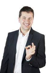 Ok! Young Manager doing ok with finger. White background.