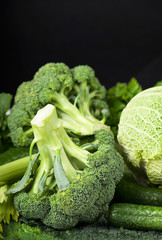 Fresh broccoli isolated on black