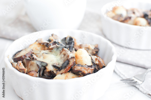 Baked gratin of cheese, mushrooms and potato