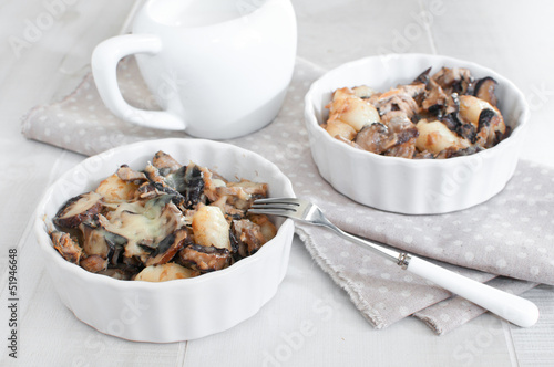 Portions of baked tuna with mushrooms