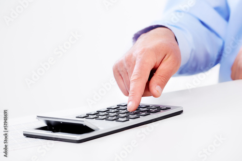 Hand with calculator.