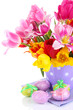 Easter composition with fresh tulips and easter eggs isolated