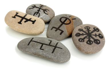 Fortune telling  with symbols on stones isolated on white