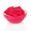 Horseradish sauce with beet in glass bowl, isolated on white
