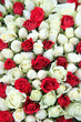 Red and white roses in a wedding centerpiece
