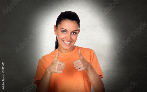 Attractive brunette woman saying Ok