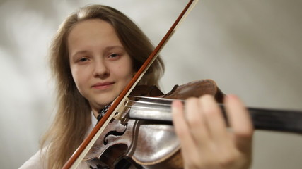 Teenager violinist, Girl playing the violin, studio shot