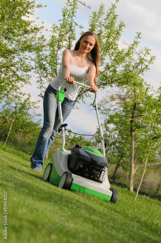 Girl mows the lawn