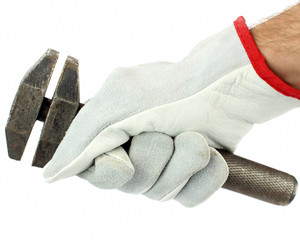 Adjustable spanner in hand with protection glove