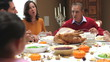Multi Generation Family Enjoying Thanksgiving Meal