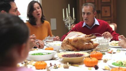 Multi Generation Family Enjoying Thanksgiving Meal
