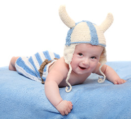 Little viking in handmade knitted costume.