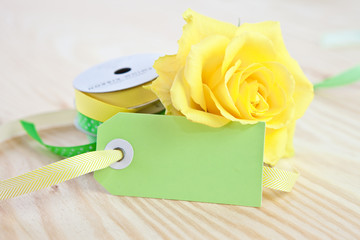 Blank tag with a yellow rose