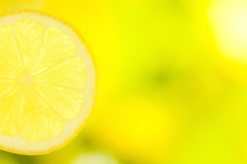slice of lemon on green and yellow background