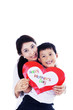 Asian mother and son holding love card - isolated