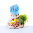 Boy chef and vegetable isolated on white