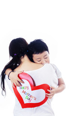 Boy hug mother holding love card on white