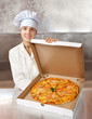 female cook with  pizza in box
