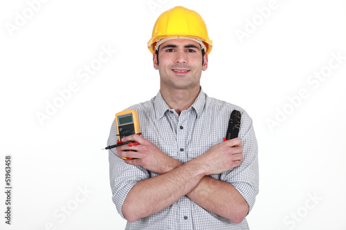 Electrician with voltmeter and clippers