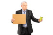 Broken businessman holding a piece of cardboard and cup