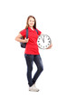 Full length portrait of a female student holding a wall clock