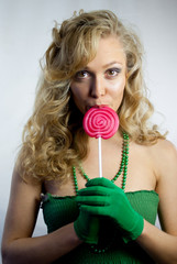 Young woman eating lollipop