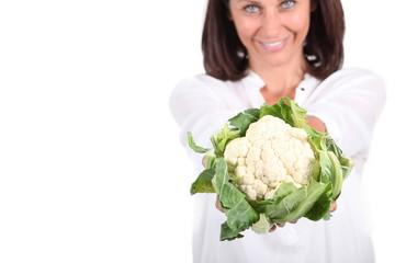 Woman holding a cauliflower