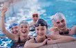 happy teen group  at swimming pool