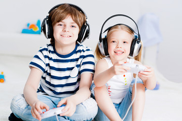 cute boy and girl playing gaming console