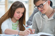 High School students. Girl and boy study together and help each
