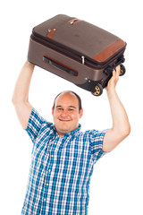 Happy traveler lifting up his luggage