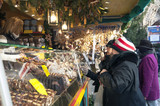 People enjoying Christmas Market with stalls in Germany.