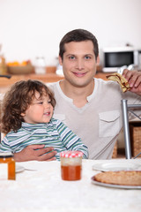 Father and son eating pancakes
