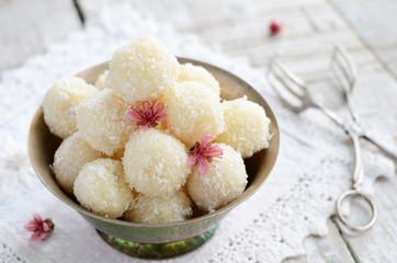 Homemade coconut bites in metal bowl